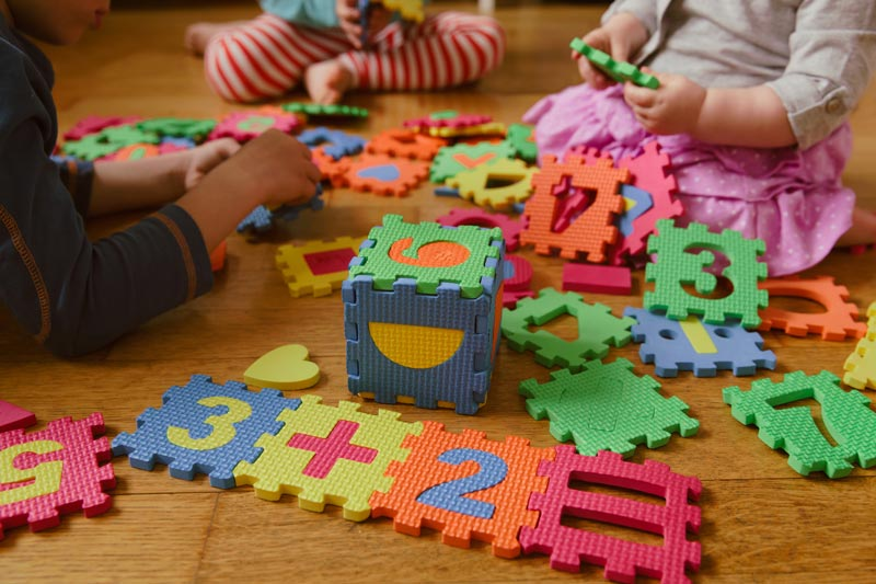 children playing with foam puzzle