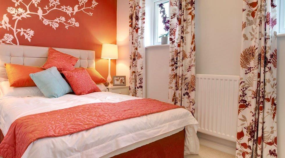 Orange themed furnished bedroom