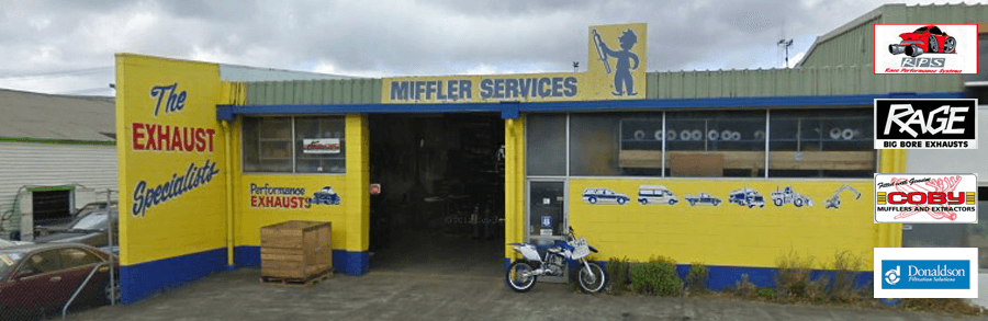 View of the Muffler Services entry gate to the shop