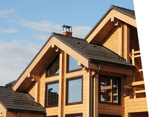 casa in legno con finestre a Monte Scudaio tre quarti sinistro esterno giorno