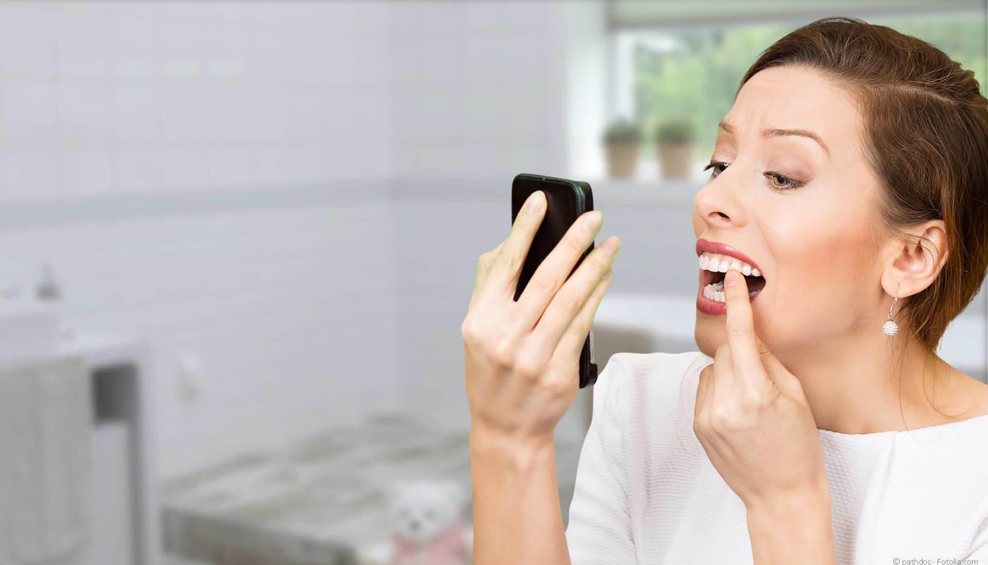 Parodontitis-Behandlung bei Zahnfleischbluten und Zahnlockerung