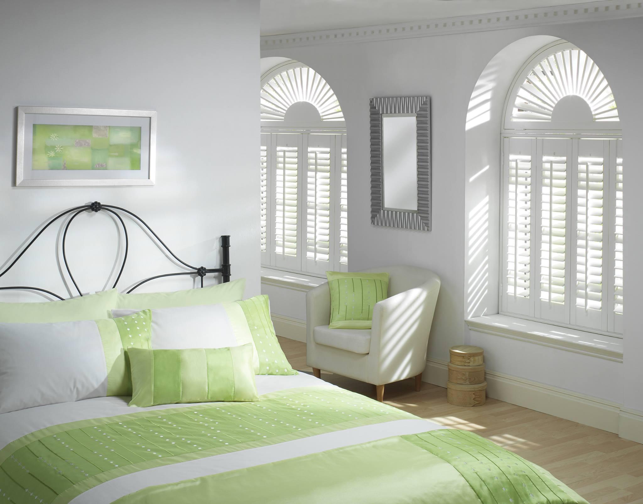 White shutters on a bedroom window