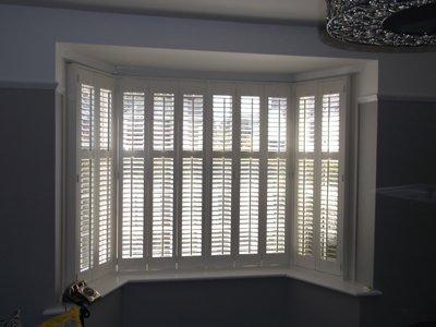 White full height shutters in a living room