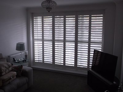 Full height shutters in a living room