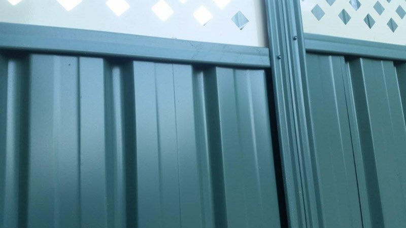 close up of green fence with lattace
