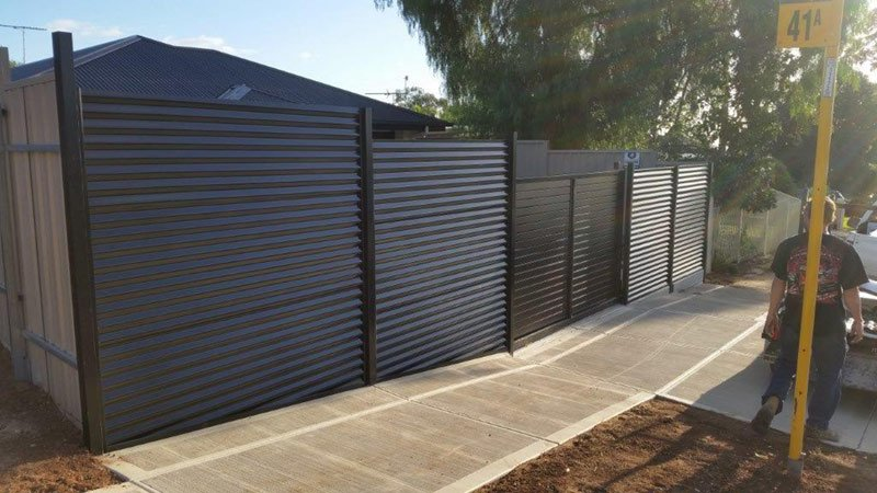 sturdy black fence with double door gate