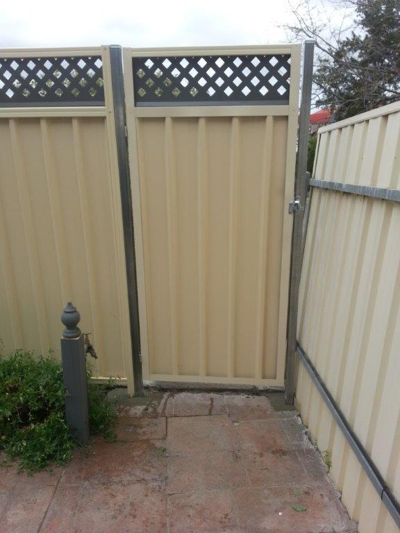 cream fence with dark lattace