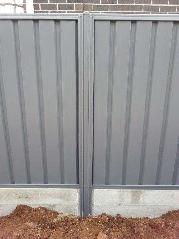 gray fence with concrete under fence