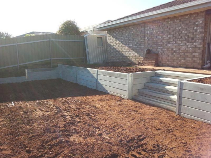 concrete stairs and fence in backyard