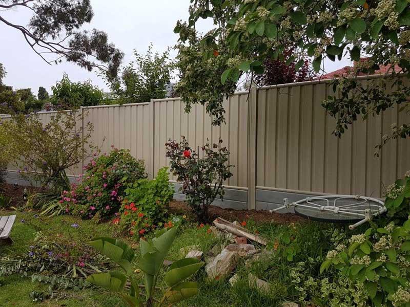 tan fence in backyard