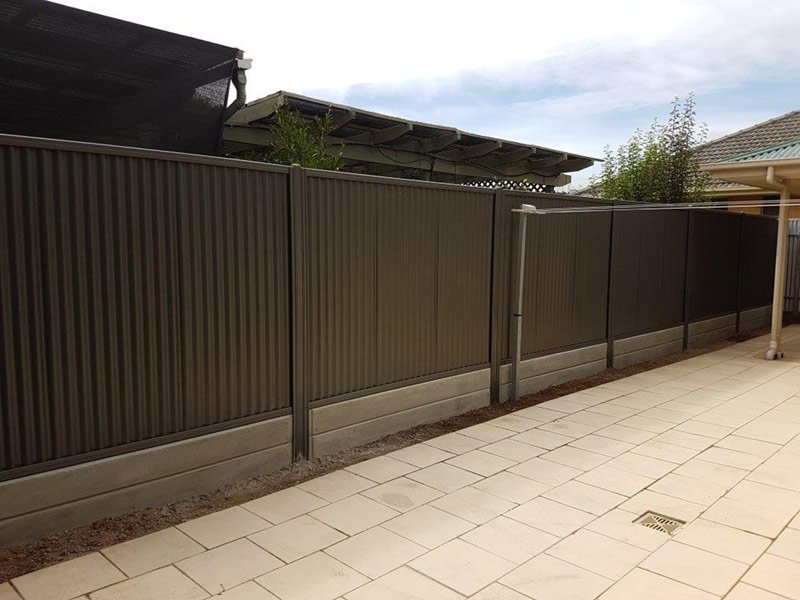 black fence with two layers of under fence