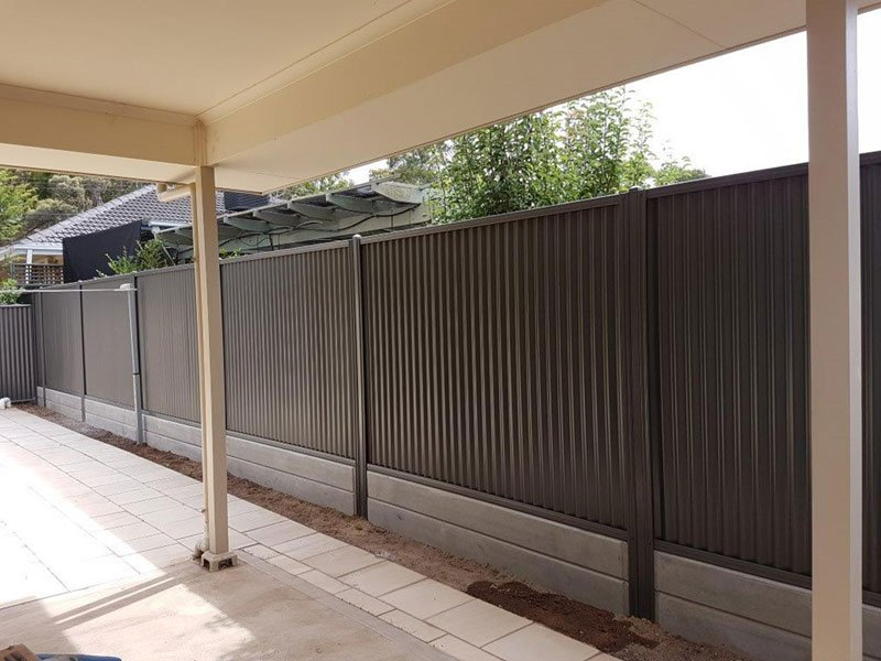 black fence by covered garage