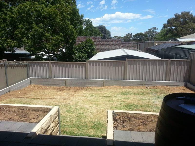 backyard with green and surrounding fence