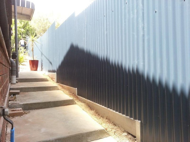 gray fence with under fence