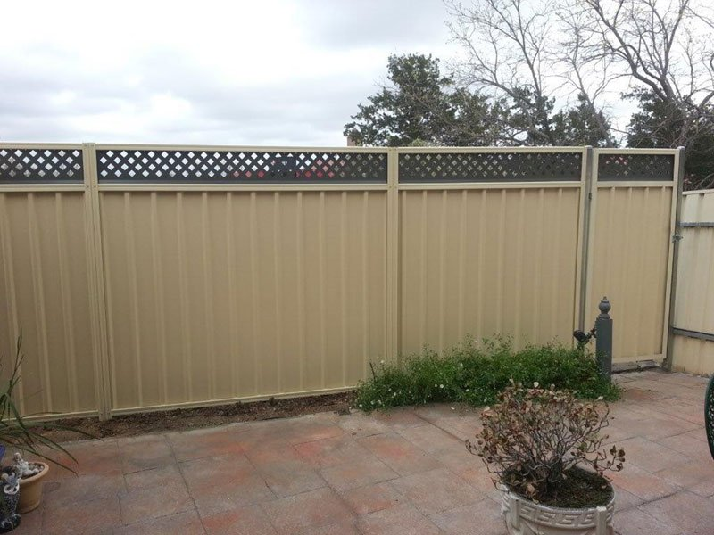 cream fence with black lattace