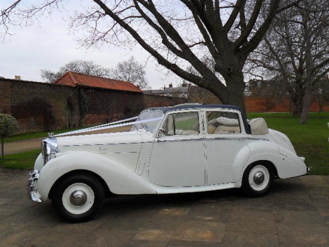 a white vintage car