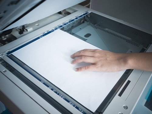 Person using xerox machine for providing outstanding copying services in Kalispell, MT