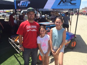 Driver of the No. 2 Loctite  Chevy Pro 2 Jeremy McGrath with two of his fans.