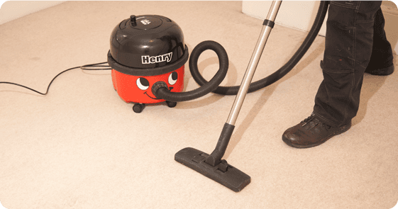 A hoover gliding over carpet