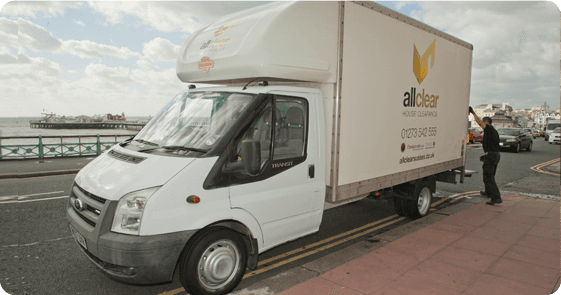 An All Clear van with a worker closing the back