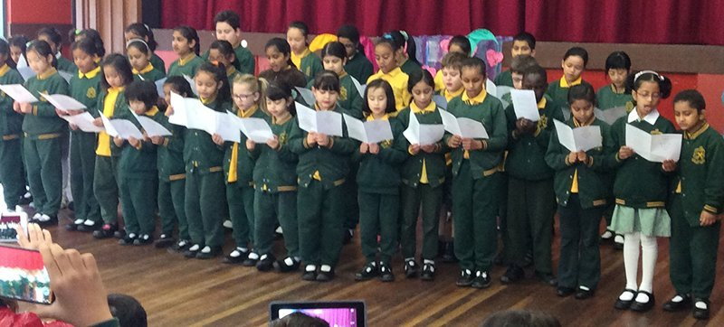 St Peter's Primary School children performing on stage