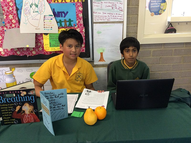 Young kids learning using laptop