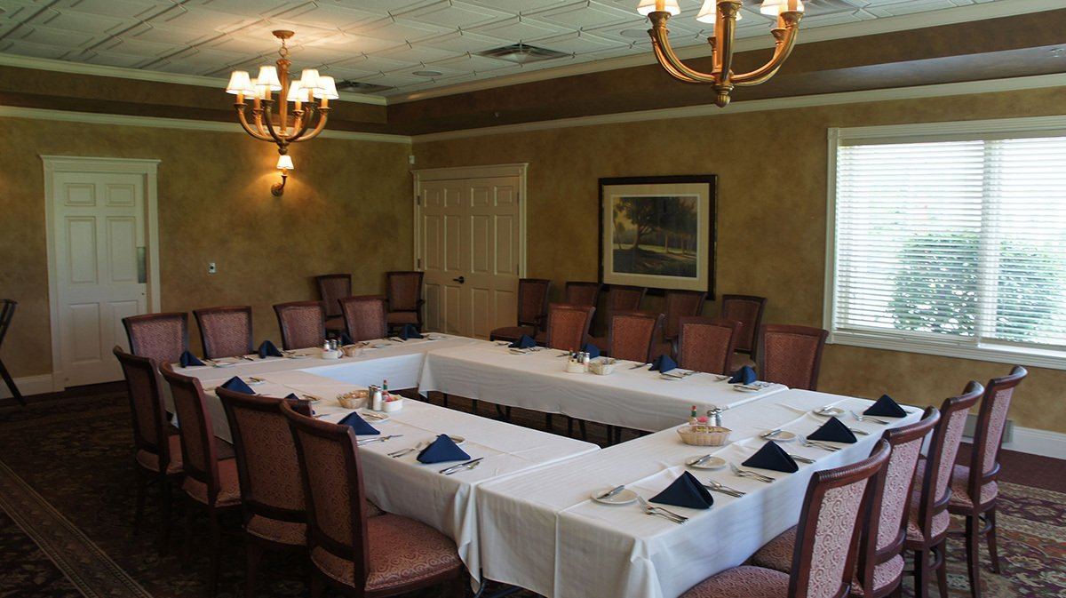 Private dining room with conference set up.