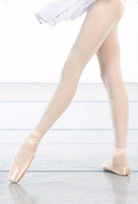 le gambe di una ballerina con delle scarpe dorate