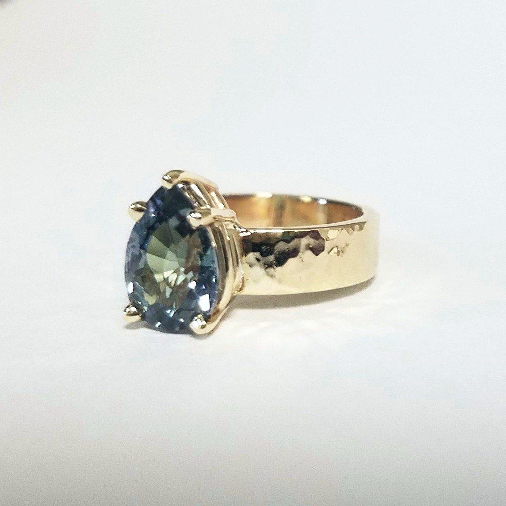 Custom Tanzanite and Hammered Gold Engagement Ring