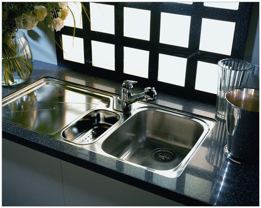 Black quartz surface installed around kitchen sink