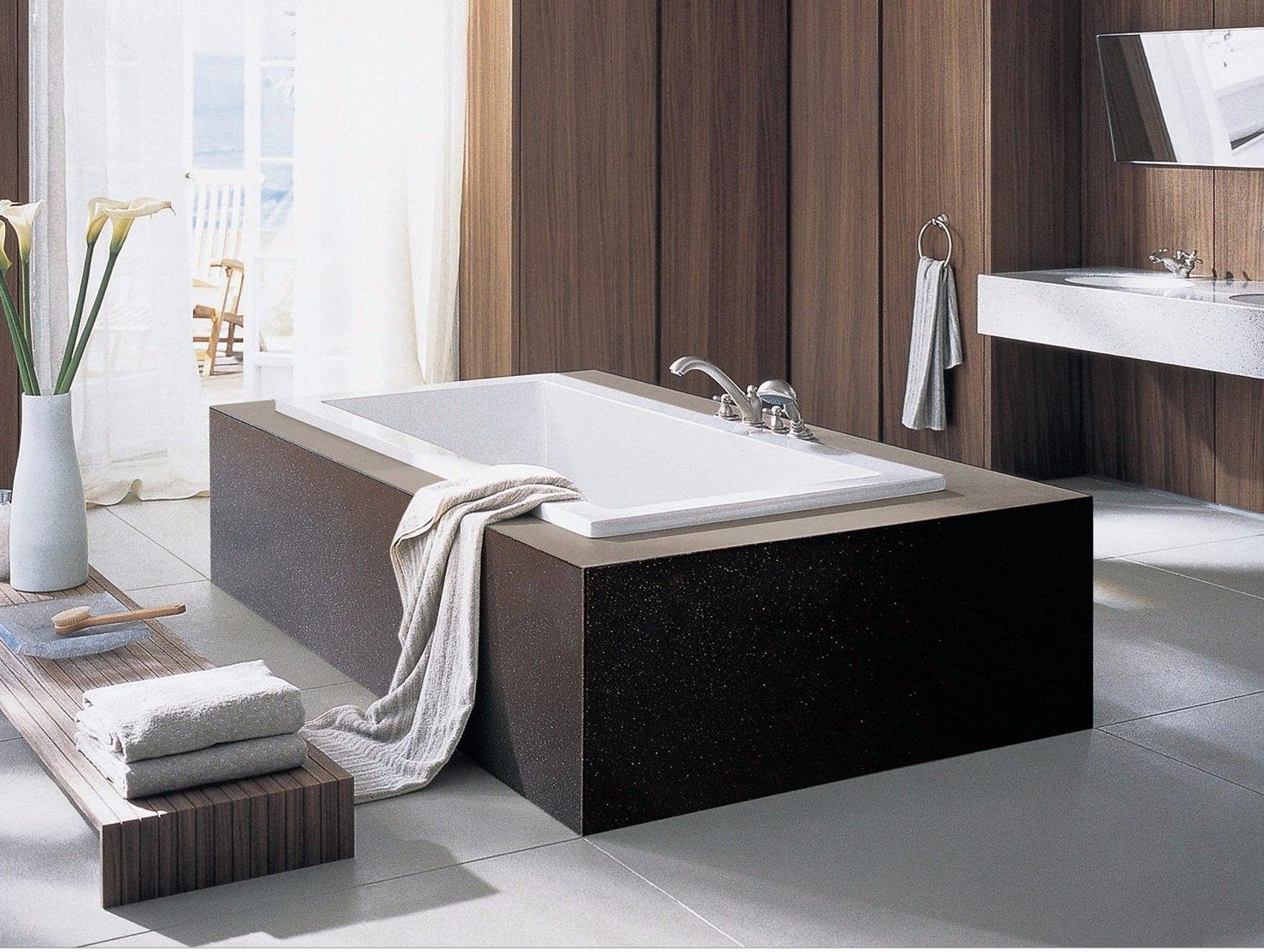 Black colour quartz surface box being made around the bath tub
