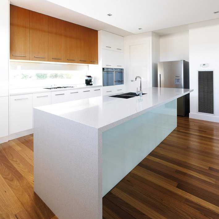 White colour tough quartz surface installed by experts in the kitchen of the customer