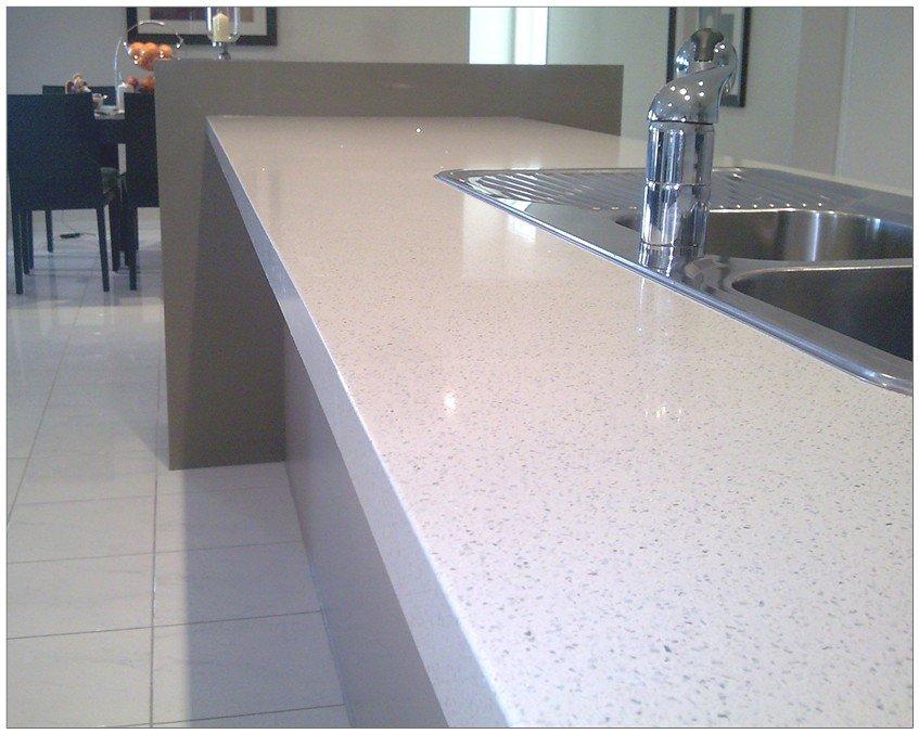 White colour quartz surface installed near the kitchen sink