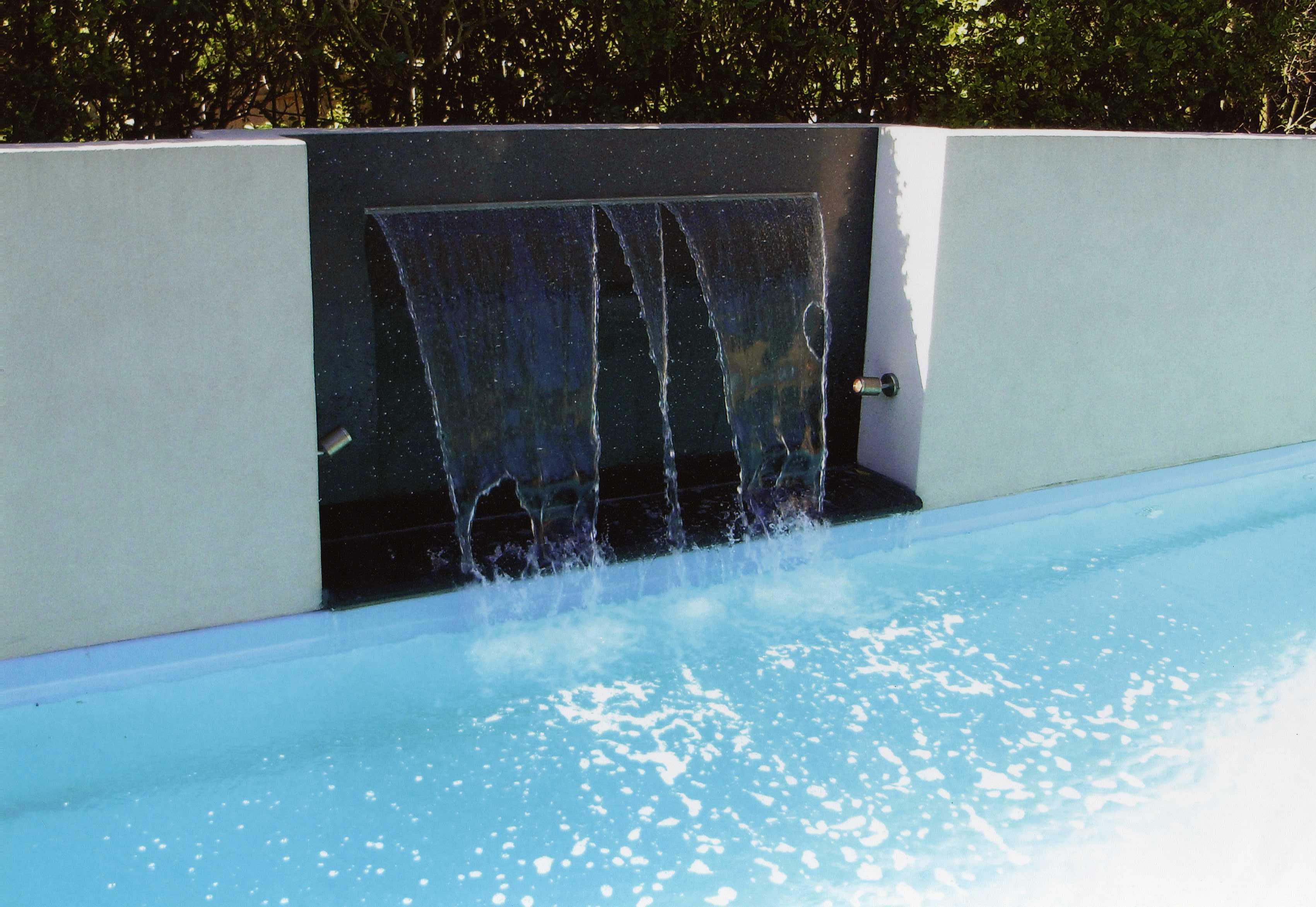 Black quartz wall installed next to the pool