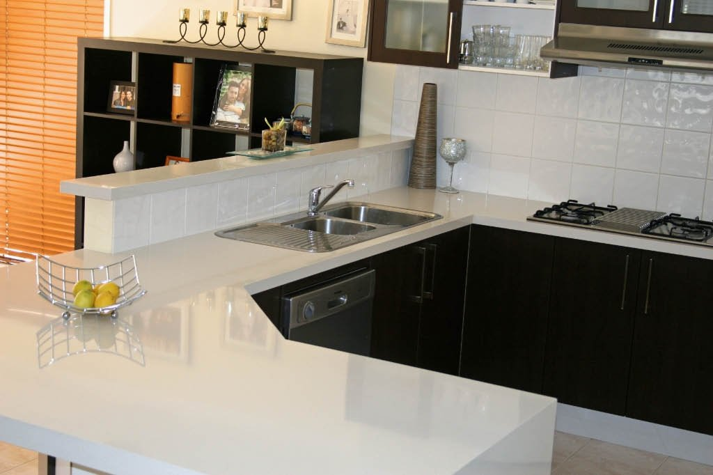 White colour quartz surface installed in the kitchen