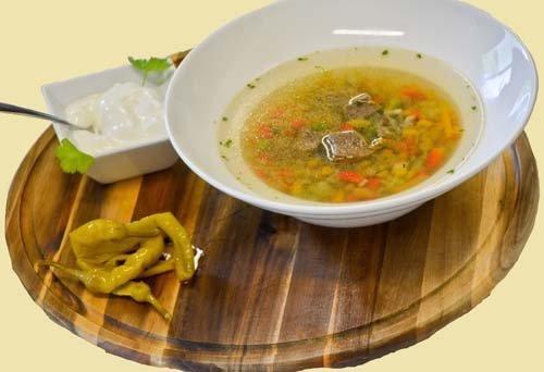 zuppa di verdure con formaggio fuso
