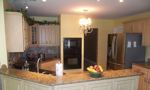 Professionally painted kitchen with appliances