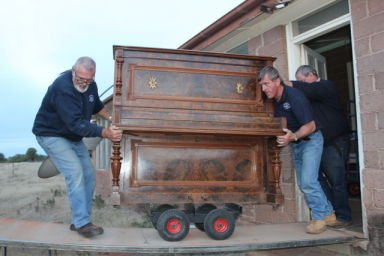 movers moving piano