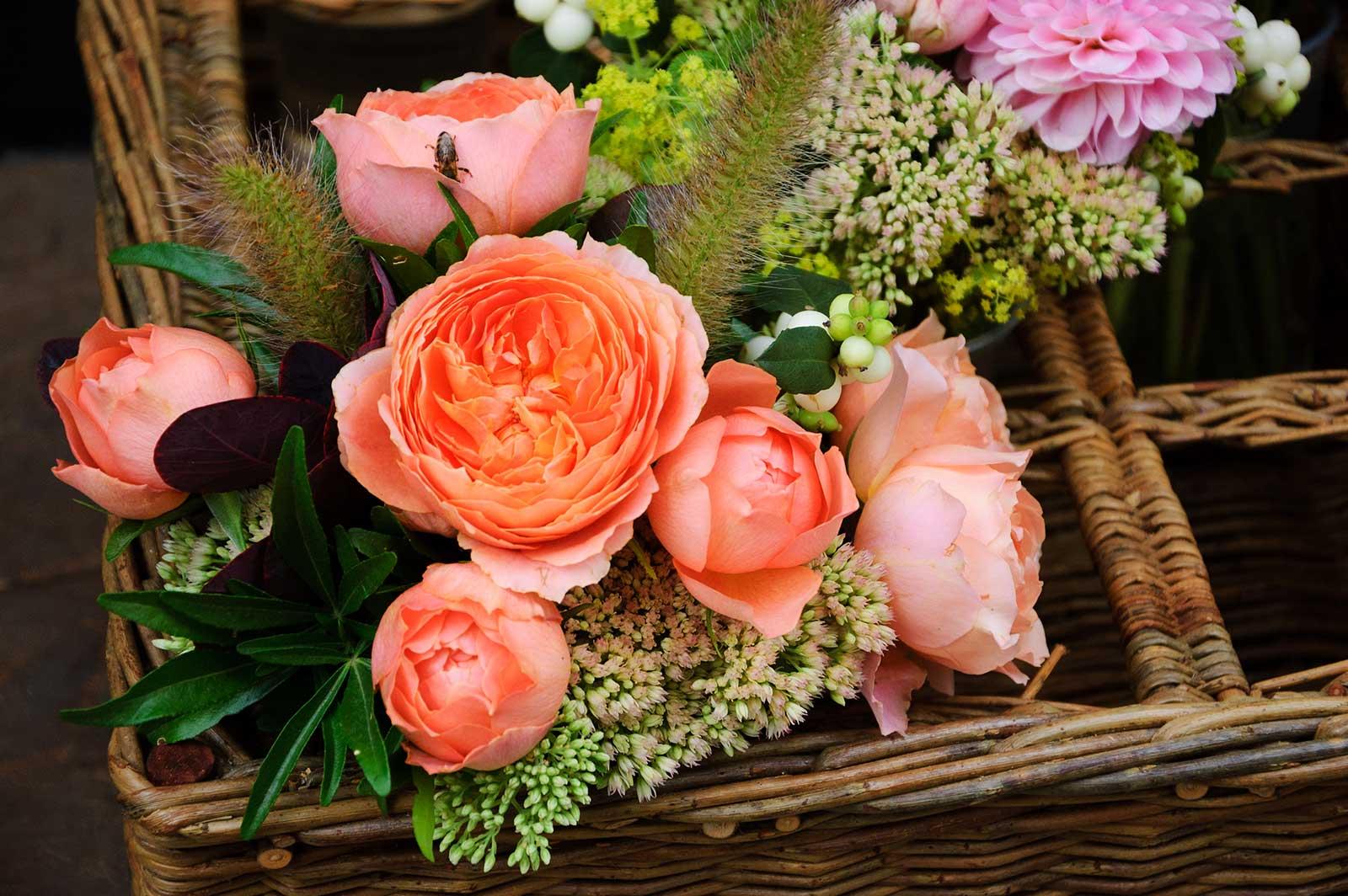 Beautiful flowers arrangement in wicker basket.