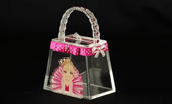 contenitore a forma di borsetta da donna