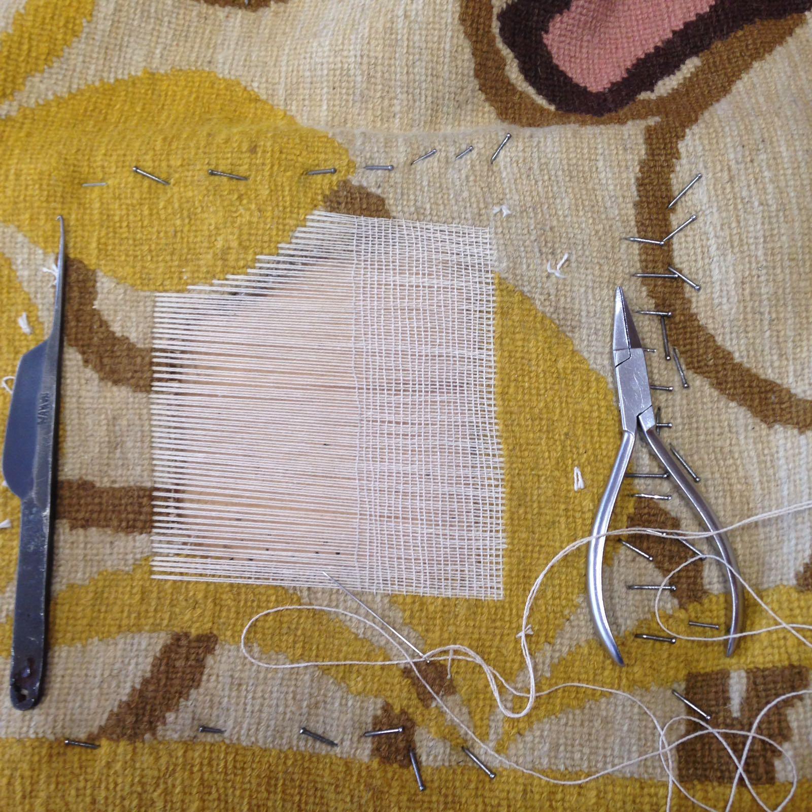 Restauro tappeto antico