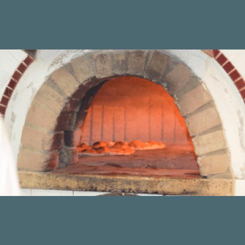 pizze cotte con forno a legna