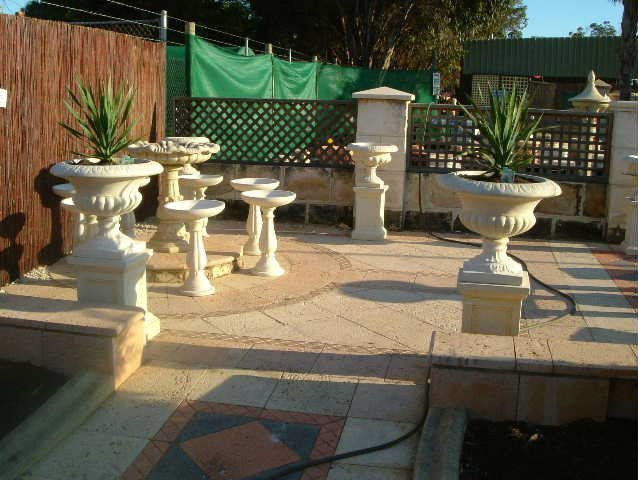 stone birdbaths and statues
