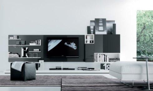soluzione salotto in bianco e nero, tappeto a righe bianche e nere, pouf cubico nero