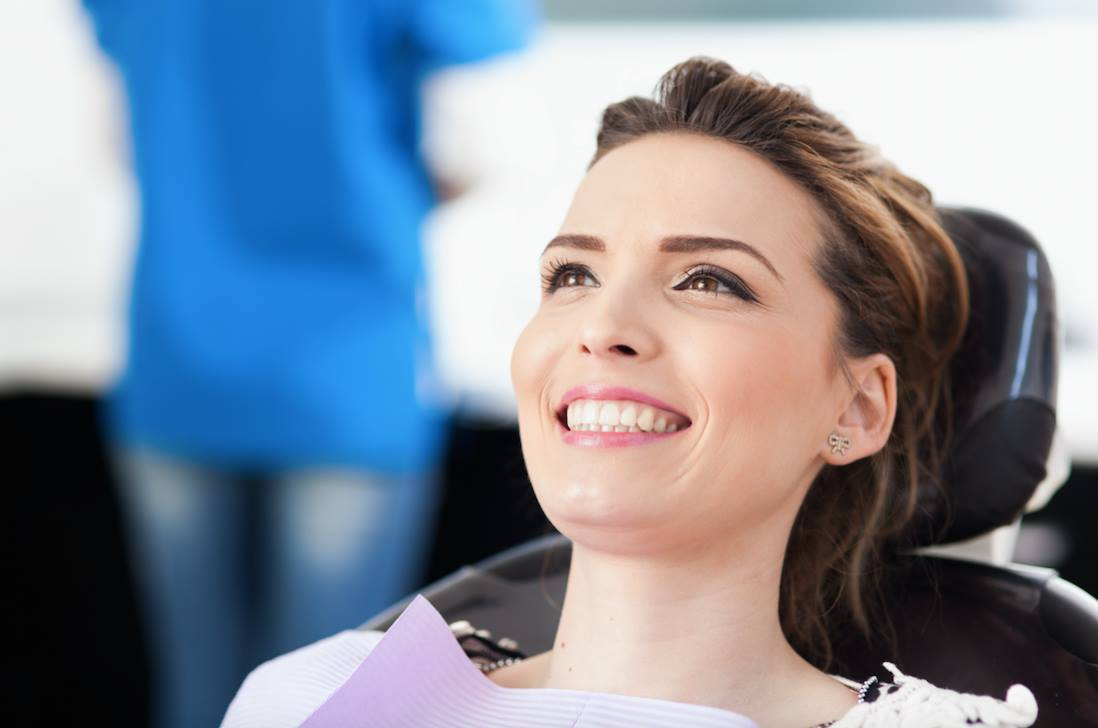 WOMAN SMILING LOOKING FOR A NEW DENTIST FAMILY DENTAL CENTRES