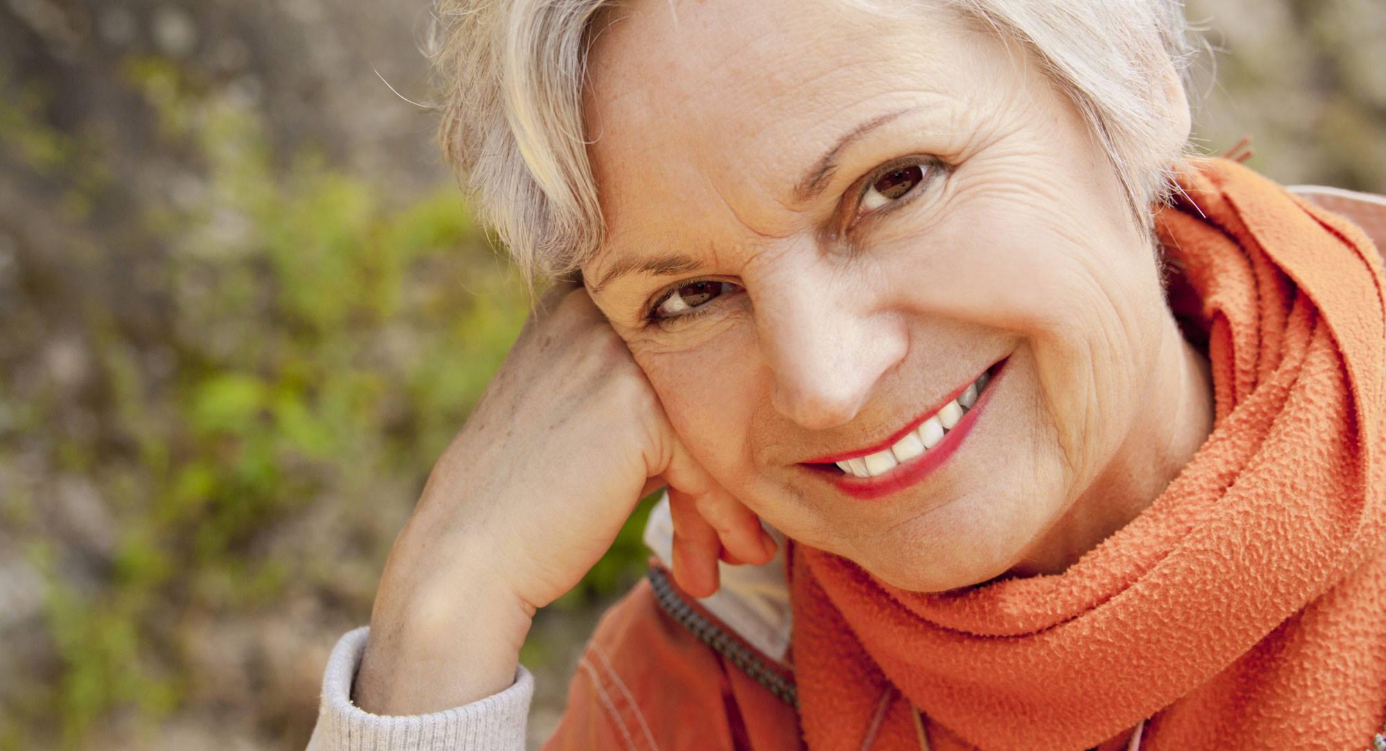 OLDER WOMAN SMILING DENTURES FAMILY DENTAL CENTRES