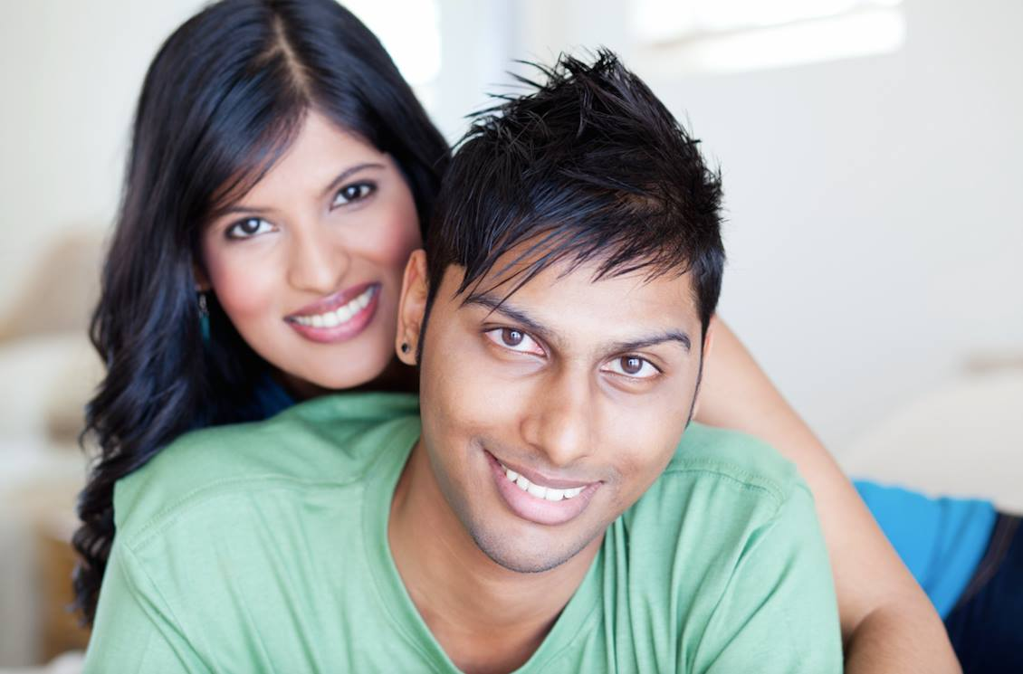HAPPY EAST INDIAN COUPLE SMILING PORCELAIN VENEERS COSMETIC DENTISTRY FAMILY DENTAL CENTRES