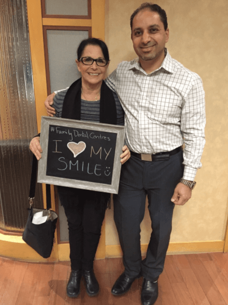 Dr Karim Lalani with a happy patient Judith at Madison Centre Family Dental in Burnaby