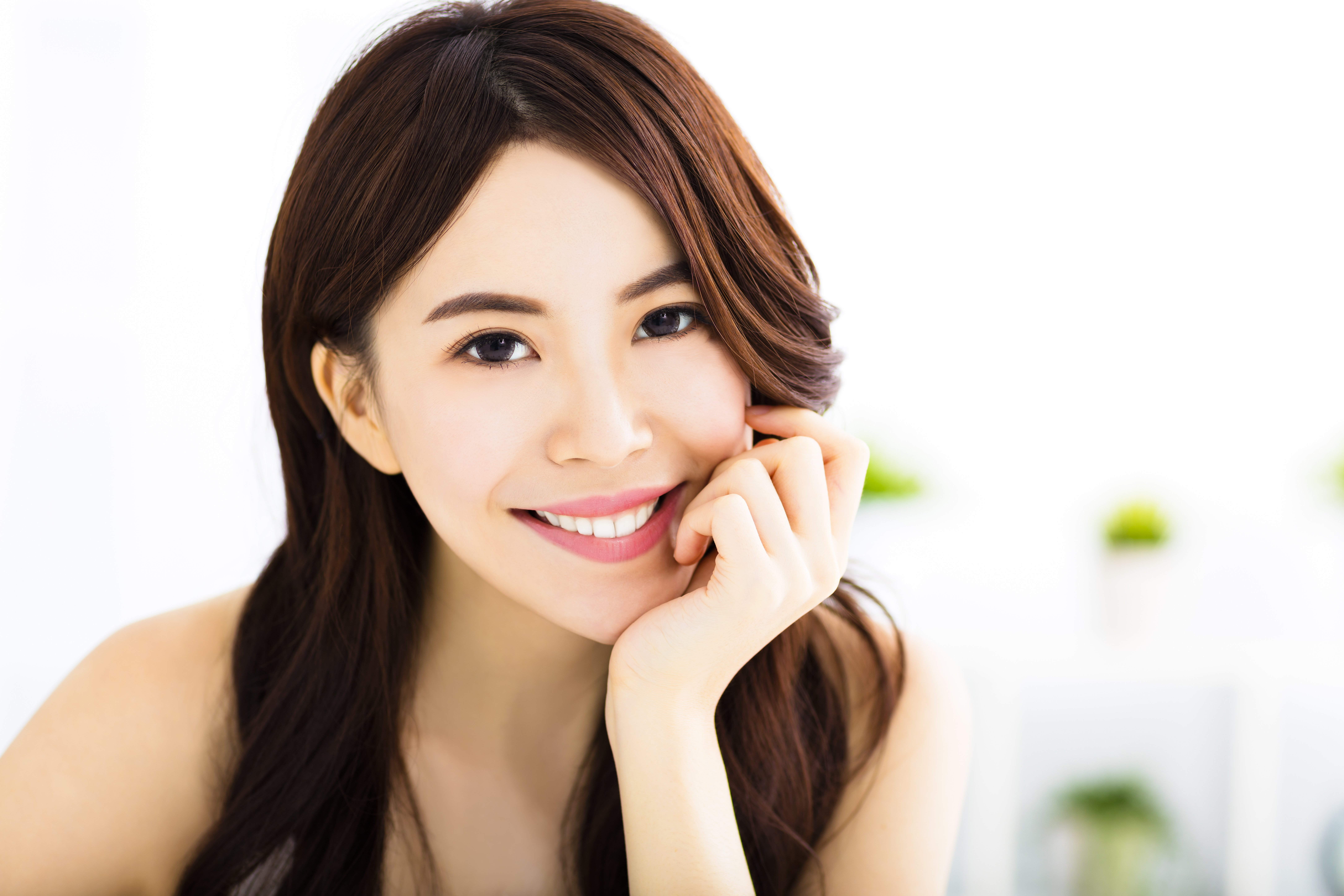 asian woman smiling healthy gums family dental centres