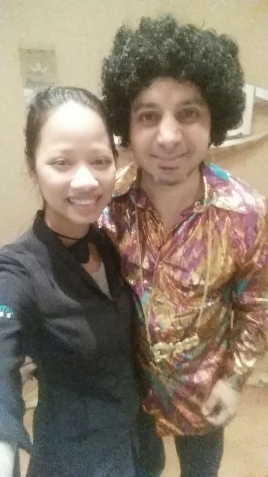 Doctor Karim Lalani at Madison Centre Family Dental sporting a disco costume for halloween
